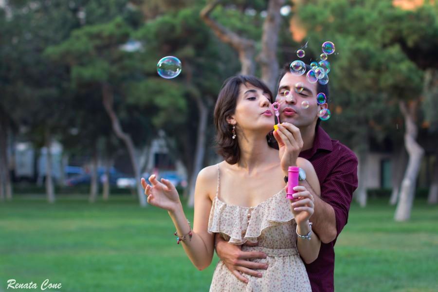 Lala and Farid blowing bubbles