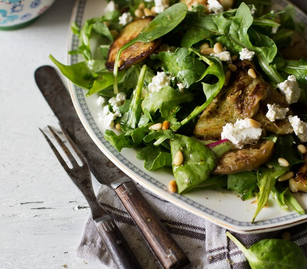 Warm eggplant salad with feta and pine nuts